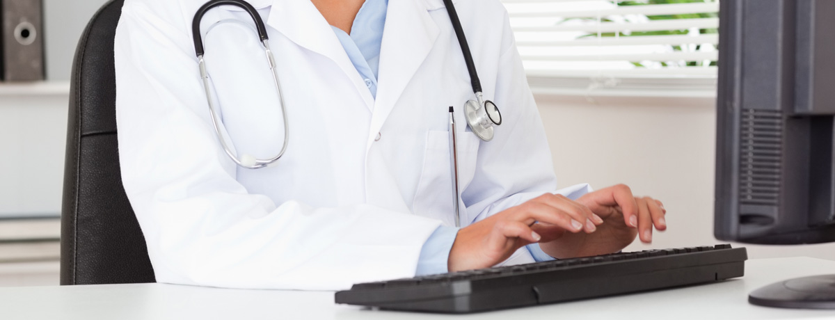 doctor-typing-medical-record